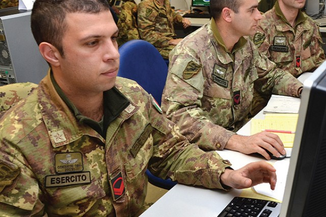 Noncommissioned Officers Ivan Costantini (from left), Rosario Fazzone and Simone Rafaelli monitor operations during Command Post Exercise training at the Vicenza Mission Training Complex on Caserma Ederle Jan. 29, 2013. Italian paratroopers of the 186th Regiment, Folgore Brigade, stationed in Pisa and Livorno, traveled to Caserma Ederle to conduct a regimental level Command Post Exercise, or CPX. The rotation was the latest in an ongoing series of joint trainings and exchanges with their airborne partners, the Sky Soldiers of the 173rd Airborne Brigade Combat Team.