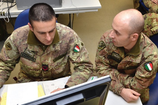 NCOs Rosario Fazzone (left) and Simone Rafaelli of 186th Parachute Regiment, Folgore Brigade, monitor operations during Command Post Exercise training at the Vicenza Mission Training Complex on Caserma Ederle Jan. 29, 2013. The paratroopers, stationed in Pisa and Livorno, traveled to Caserma Ederle to conduct a regimental level Command Post Exercise, or CPX. The rotation was the latest in an ongoing series of joint trainings and exchanges with their airborne partners, the Sky Soldiers of the 173rd Airborne Brigade Combat Team.