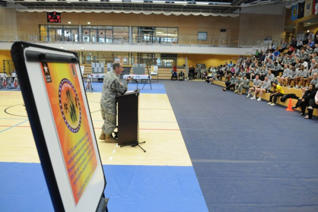 "LUCIUS D. CLAY KASERNE, Germany (January 30, 2013) "" Command Sgt. Maj. Davenport, U.S. Army Europe, speaks to more than 400 Soldiers , Civilians, Local Nationals and Family members about the importance of fitness during 5th Signal Command's Fit to Lead kick-off event. 5th Signal Command launched their theater-wide Fit to Lead initiative at the Clay Kaserne Fitness Center. Fit to Lead is a health and fitness program that centers on mentors linking up with teams and individuals to accomplish achievable goals."