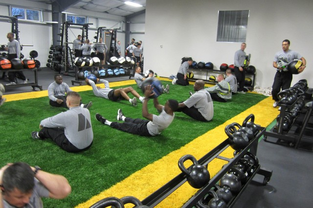 Soldiers perform exercises in the new Combat Readiness Training Facility on Wheeler-Sack Army Airfield on the facilities official opening Jan. 15.  The facility, part of Fort Drum's functional fitness initiative, provides Soldiers a second indoor fitness facility on the airfield.