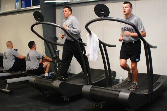 Soldiers exercise on The Curve, a motorless treadmill that operates according to the position and effort of the user. The Curve is one of several new pieces of exercise equipment the 10th Combat Aviation Brigade recently received as part of the Fort Drum functional fitness initiative.