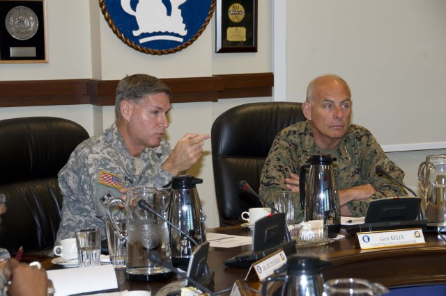 Marine Gen. John F. Kelly (right), commander, U.S. Southern Command (SOUTHCOM), receives a briefing from Maj. Gen. Frederick S. Rudesheim (left), commanding general, U.S. Army South, at the Army South headquarters here Jan. 15.