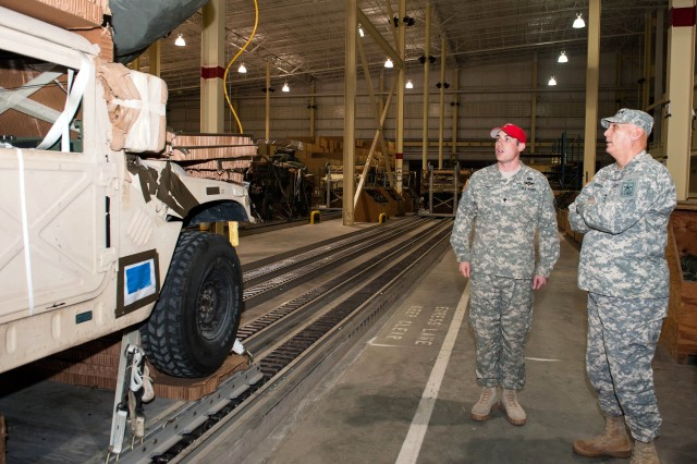 A U.S. Army Rigger from 264th Battalion, 82nd Sustainment Brigade,  briefs Army Chief of Staff Gen. Raymond T. Odierno  on heavy drop rig procedures at Pope Field, NC. Jan. 30, 2013.  Gen. Odierno also visited the U.S. Army Special Operations Command (USASOC) and U.S. Army Forces Command (FORSCOM).  (U.S. Army photo by Staff Sgt. Steve Cortez/ Released)