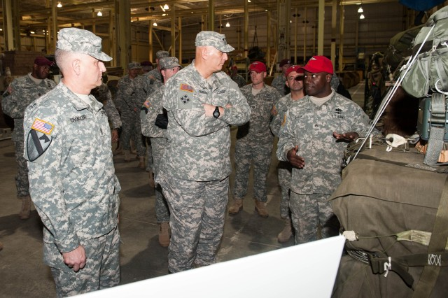 A U.S. Army Rigger from 264th Battalion, 82nd Sustainment Brigade,  briefs Army Chief of Staff Gen. Raymond T. Odierno and Sergeant Major of the Army Raymond F. Chandler III  on heavy drop rig procedures at Pope Field, NC. Jan. 30, 2013.  Gen. Odierno and SMA Chandler also visited the United States Army Special Operations Command (USASOC) and United States Army Forces Command (FORSCOM).  (U.S. Army photo by Staff Sgt. Steve Cortez/ Released)