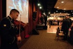 Spc. Ean Ulrich plays a violin for the formal all-ranks ball