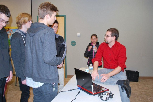 Following the brain-computer interaction presentation, Dr. Brent Lance, Human Research and Engineering Directorate, answers questions from some of the students that attended the Science Café.