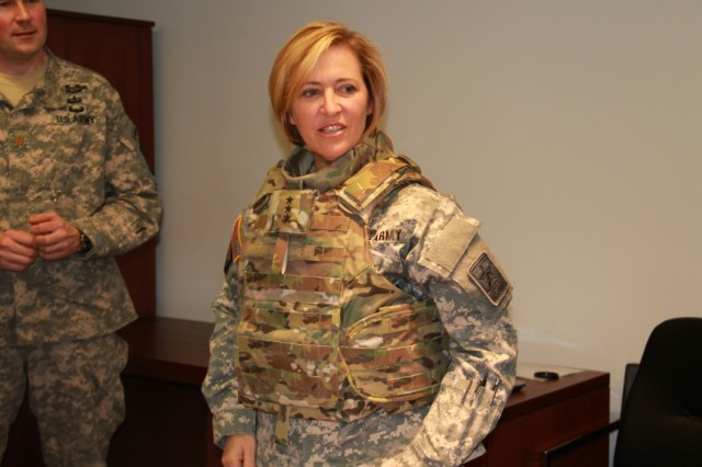 Lt. Gen. Patricia Horoho, Army surgeon general, tries on the new tactical vest specifically designed for the female physique. While providing the same high-level ballistic protection, it has an improved quick release system, narrower shoulders, front ballistic plate insertion, more adjustability in the waist area, and a collar that can accommodate the regulation hair styles worn by women in the field.