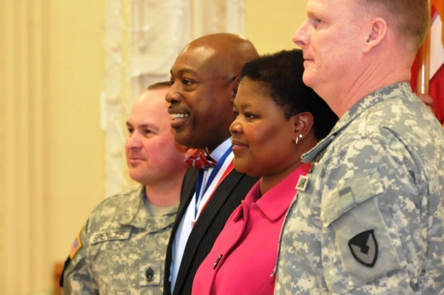 From left, Army Sustainment Command's Command Sgt. Maj. James E. Spencer, James  E. Salter Jr., his wife, Bernadette, and Brig. Gen. Duane A. Gamble, deputy commanding general, gather for a photo during the quarterly retirement & retreat ceremony Jan. 31 at Heritage Hall in Building 60. (Photo by Jon Micheal Connor, ASC Public Affairs)