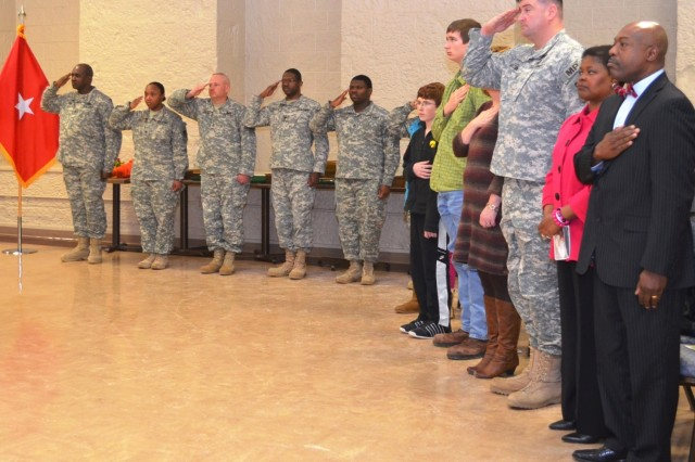 Retiring ASC personnel and family members, along with Soldiers assisting in awards presentation, render honors during the retirement & retreat ceremony. (Photo by Jasmine Phillips, ASC Public Affairs)