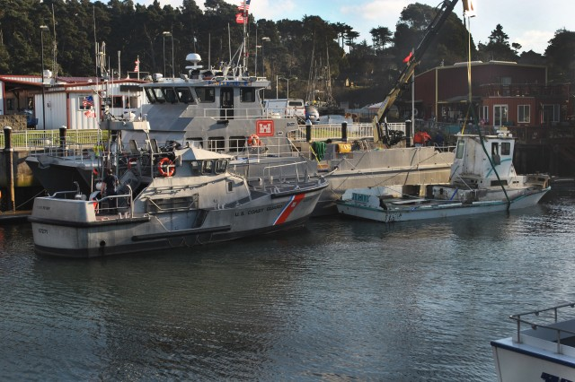 """The San Francisco District's MV John A.B. Dillard, Jr., is docked at the U.S. Coast Guard Noyo River Station after removing a 50-foot, 15 ton hazardous sunken ship stranded across half of the Noyo river federal channel.  The crew of the Dillard and district scuba divers raised the """"Jeanne"""" from a depth of 12 to 15 feet, pumped water from her cargo holds and towed to the ship to the Coast Guard Station, before transferring control and custody of the ship to the Noyo Harbor District."""