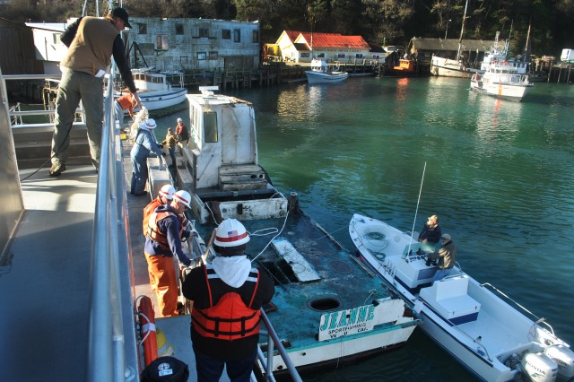 """The San Francisco District's MV John A.B. Dillard, Jr., is docked at the U.S. Coast Guard Noyo River Station after removing a 50-foot, 15-plus ton hazardous sunken ship stranded across half of the Noyo river federal channel.  The crew of the Dillard and district scuba divers raised the """"Jeanne"""" from a depth of 12 to 15 feet, pumped water from her cargo holds and towed to the ship to the Coast Guard Station, before transferring control and custody of the ship to the Noyo Harbor District."""