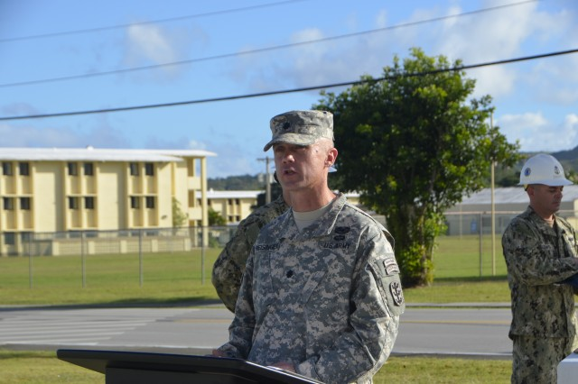 "Lt. Col. Aaron Reisinger, 84th Engineer Battalion, 130th Engineer Brigade, 8th Theater Sustainment Command's commanding Officer speaks to a formation of Navy SeaBees and Army Engineers about the intent to leave a legacy and ""live up to and honor the SeaBees contribution to the Navy, Guam, and this region,"" at Camp Covington, U.S. Naval Base Guam, Jan. 17."