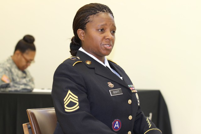 Sgt. 1st Class Cavornia Scott, a senior instructor with the 94th Training Division, answers questions from a panel of senior noncommissioned officers during the United States Army Reserve Command Sergeant Audie Murphy Club board, hosted by the 80th Training Command (TASS) at the command headquarters, Richmond, Va., Feb. 1, 2013.