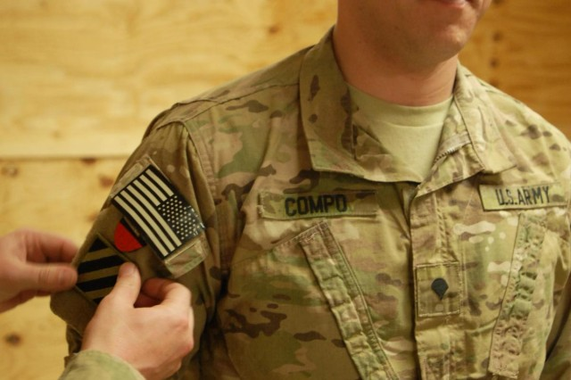 Security Forces Advisory Team Commander Lt. Col. William Phillips places the Marne combat patch on the right sleeve of Spc. Kyle Compo during a patching ceremony conducted at Multi National Base Tarin Kot, Afghanistan on Jan. 31, 2013. The 3rd Infantry Division has been deployed more than any other active duty U.S. Army unit, and soldiers wear their patch proudly.