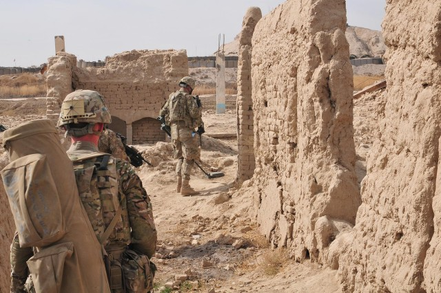 A soldier with 1st Battalion, 38th Infantry Regiment, Combined Task Force 4-2 (4th Stryker Brigade Combat Team, 2nd Infantry Division), leads a foot patrol using a Mine Hound to detect any improvised explosive devices on their path, Jan.29 in Panjwa'i District, Afghanistan. The soldiers, from Joint Base Lewis-McChord, Wash., are currently serving in Afghanistan in support of Operation Enduring Freedom. (U.S. Army photo by Sgt. Kimberly Hackbarth, 4th SBCT, 2nd Inf. Div. Public Affairs Office)
