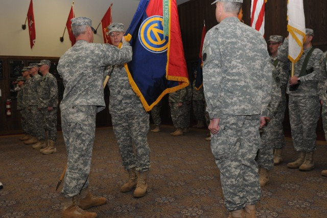 Maj. Gen. Bill Gerety, commander 80th Training Command (TASS), passes the 102nd Training Division colors to Col. Wayne M. Cavender during a change of command ceremony at Fort Leonard Wood, Mo., Feb. 3, 2013.