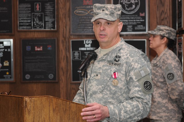 Brig. Gen. Thomas P. Evans former 102nd Training Division commander delivers his farewell address during a Change of Command Ceremony where he relinquished command to Col. Wayne M. Cavender at Fort Leonard Wood Mo.; Feb. 3; 2013.