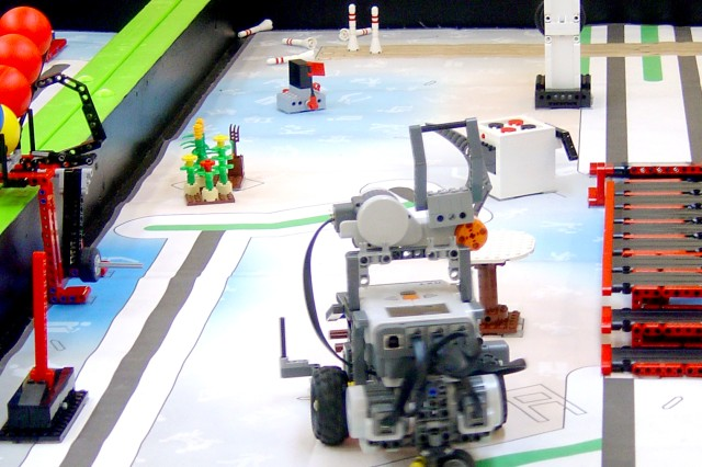 The Electrobots' robot heads over to pick up a chair for repair after placing blue quilts in the proper position at a FIRST LEGO League competition, Jan. 26, 2013. Seven students, sponsored by U.S. Army Research Laboratory and Aberdeen Proving Ground, Md., took top honors at the FIRST LEGO League competition at the University of Delaware, Jan. 26.