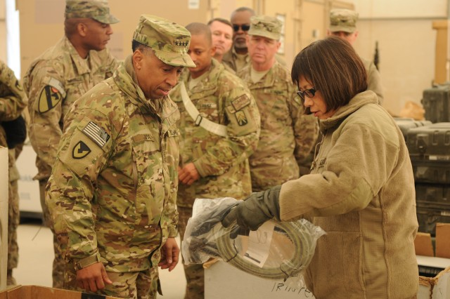 While visiting Kandahar Airfield, Afghanistan, Jan. 16, Heidi Shyu, assistant secretary of the Army for acquisition, logistics and technology, and AMC commander Gen. Dennis Via inspect equipment.