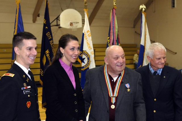 """(From left to right) Capt. Michael Centola, rear detachment commander of 4th Battalion, 9th Infantry Regiment, 4th Stryker Brigade Combat Team, 2nd Infantry Division, U.S. Rep. Jaime Herrera Beutler, representing Southwest Washington's 3rd District, William V. Wuorinen, Silver Star recipient, and retired Lt. Col. Gil Blue, after an award ceremony held at Naselle-Grays River Valley School, Naselle, Wash., Jan. 30, 2013. The Silver Star Medal was presented to Wuorinen for his """"gallantry in action"""" between March 16, 1953, and March 17, 1953, while serving as an infantryman."""