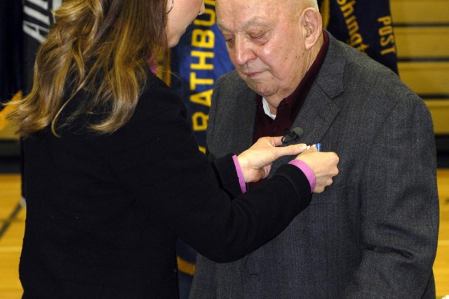"""U.S. Rep. Jaime Herrera Beutler pins the Silver Star Medal onto William V. Wuorinen during an award ceremony held at Naselle-Grays River Valley School, Naselle, Wash., Jan. 30, 2013. The award was given for his """"gallantry in action"""" between March 16, 1953, and March 17, 1953, while serving as an infantryman. Wuorinen was assigned to 1st Platoon, Company L, 3rd Battalion, 9th Infantry Regiment, 2nd Infantry Division, during the Korean War. Then Pfc. Wuorinen's heroic actions during combat operation contributed to the overwhelming success of the command's mission to drive Chinese forces from Hill 355 in the vicinity of Un-Dong, North Korea."""
