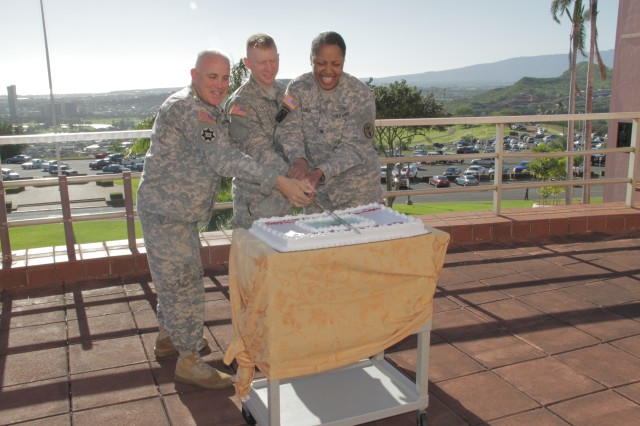 HONOLULU -- Tripler Army Medical Center's Department of Nursing celebrated the 112th Anniversary of the Army Nurse Corps with a cake cutting ceremony, Feb. 1 on the CG's Lanai, here, to honor the quality care and selfless service the ANC has been providing for more than 100 years.  Pictured left to right: Col. Larry Connell, acting commander and chief of staff, Pacific Regional Medical Command and Tripler Army Medical Center; 2nd Lt. Ryan Sinteff, youngest registered nurse at TAMC; and Col. Glenda Lock, deputy commander for nursing, PRMC and TAMC.