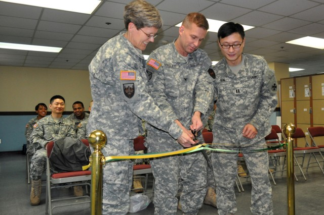A ribbon cutting ceremony takes place with Capt. Howard Sun, officer-in-charge of the Yongsan Tax Center, Col. Michael E. Masley, garrison commander for USAG Yongsan, and Col. Amrein Marian, the staff judge advocate of U.S. Forces Korea, left to right, Jan. 30. (U.S. Army photo by Pfc. Jung Jihoon)