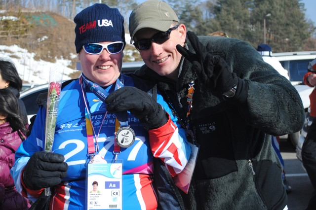 Team USA Member Tanya Hall (left) and her brother Capt. Jason Hall celebrate her Silver Medal win in the 50-meter cross country race at the Winter Special Olympics in Pyeongchang, South Korea.