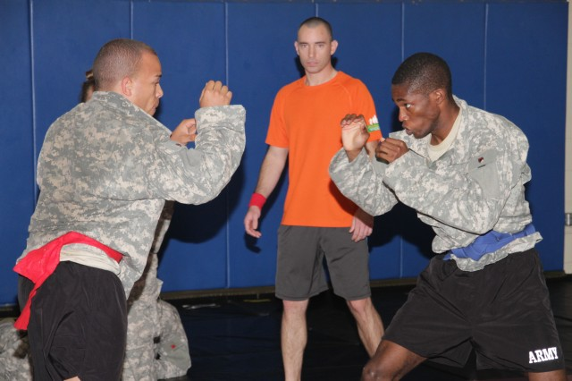 "HONOLULU "" Soldiers from Tripler Army Medical Center and U.S. Army Health Clinic-Schofield Barracks graduated the Army Combatives Course, Level 2, after weeks of daily intense training, Feb. 1."