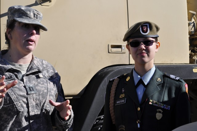 Simi Valley, Calif., native Capt. Cathy Zimmerman (left), a logistics officer assigned to Headquarters and Headquarters Troop of the Ironhorse Brigade, explains the importance of upgrading communication systems to Krista Masters, a sophomore at Killeen High School, during Groundhog Job Shadow Day Jan. 30, Fort Hood, Texas.