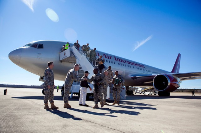 About 250 Soldiers with the 3rd Armored Brigade Combat Team disembark from a plane Feb. 1 at Lawson Army Airfield.