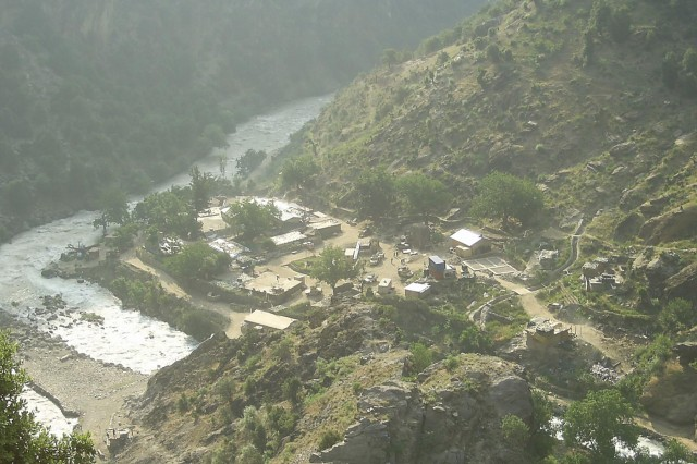 Pictured is a view of Combat Outpost Keating on the Pakistan-Afghanistan border in a remote pocket of Afghanistan, known as Nuristan. According to Soldiers who called the outpost home, being at Keating was like being in a fishbowl or fighting from the bottom of a paper cup. It was there, surrounded by mountains and insurgents, that former Staff Sgt. Clinton L. Romesha and his fellow Soldiers fought back the enemy in a fierce 12-hour battle, Oct. 3, 2009.