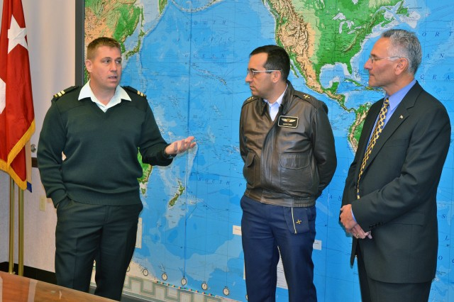 From left, at the Security Assistance Command office in New Cumberland, Pa., are Capt. Paul Walsh, Canadian security assistance liaison officer; Col. Henry Quintero, Colombian Air Force and SALO representative; and Christ Megoulas, SALO program manager. Liaison officers are assigned to USASAC to manage Foreign Military Sales cases for their respective countries.