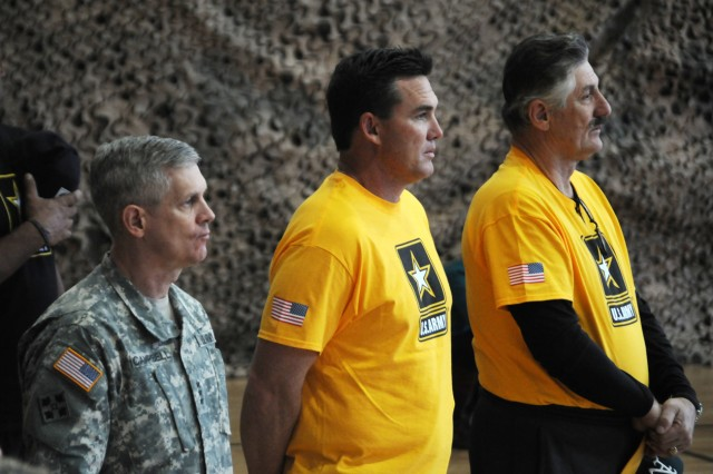 From left: Lt. Gen. Don Campbell, commander, U.S. Army Europe, Tim Salmon and Rollie Fingers watch the colorguard as it prepares to present the colors prior to the start of the Fox Sports wiffleball game at the Grafenwoehr Physical Fitness Center, Feb. 6.
