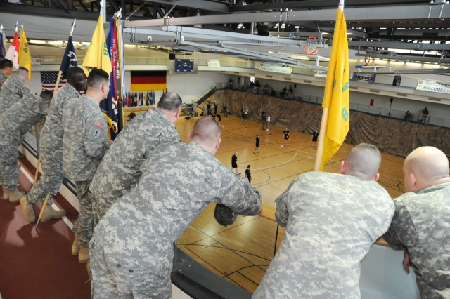 Soldiers watch from the upper deck at the Grafenwoehr Physical Fitness Center prior to the start of the Fox Sports wiffleball game, Feb. 6.