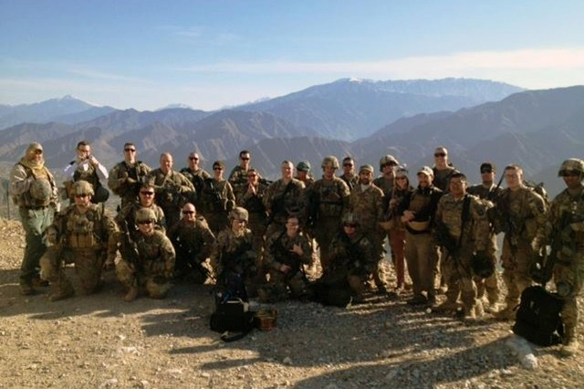 Members of Combined Team Bastogne, 1st Brigade Combat Team, 101st Airborne Division and Provincial Reconstruction Team Kunar pose for a photo Jan. 24, 2013, after completing the treacherous hike to the top of Observation Point Bull Run near Camp Wright and Asadabad, the capital city of Kunar province, Afghanistan. (Courtesy photo by U.S. Army 1st Lt. Lisa Maginot, Task Force 426)