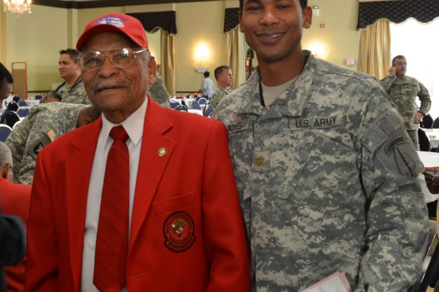 Reverend John Jones of Lumberton, N.C. attended the 8th Military Information Support Group (Airborne) event during the African American Heritage Observance program at the Fort Bragg Club. Joining Rev. Jones is his son, Courtney, a major in the Military Information Support Operations Command.