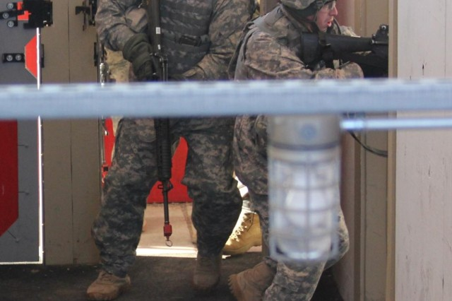 Soldiers from A Battery, 2nd Battalion, 4th Field Artillery clear rooms at the Urban Assault Course Jan. 16. This was one of many rehearsals teams went through in order to commit the movements to muscle memory.