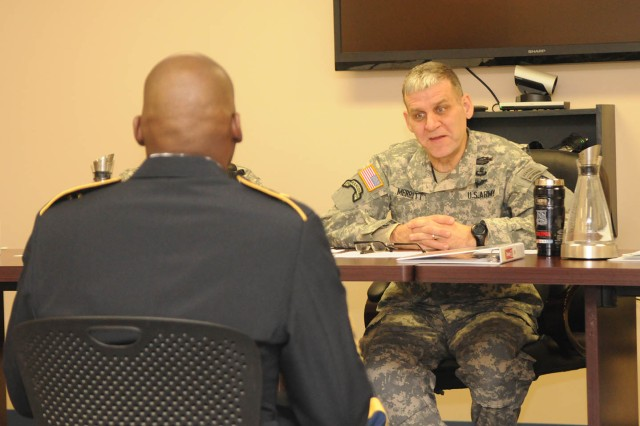 Command Sgt. Maj. Rick Merritt, 10th Mountain Division (LI) senior enlisted adviser, quizzes a Sgt. Audie Murphy Club candidate during the organization's first board last month.