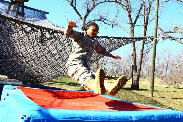 Basic Combat Training Pvt. Shanice Gilliard performs an L-drop at the end of the inverted rope descent obstacle Jan. 31 at the Confidence Obstacle Course. Soldiers from C Battery, 1st Battalion, 40th Field Artillery, went through about two dozen stations testing their balance, strength, mental toughness and endurance.