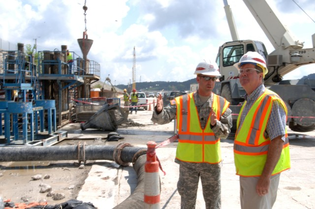 """Lt. Col. James A. DeLapp, U.S. Army Corps of Engineers Nashville District commander, leads Nashville Mayor Karl Dean on a tour of the work platform at Wolf Creek Dam near Jamestown, Ky., Aug. 7, 2012. The Corps is installing a barrier wall through the embankment deep into bedrock below the foundation. Dams are an important part of the Corps' infrastructure improvement projects, said Jo-Ellen Darcy, assistant secretary of the Army for Civil Works, during a Feb. 7, 2013, Senate Environment and Public Works Committee """"Oversight Hearing on Implementation of Corps of Engineers Water Resources Policies."""""""