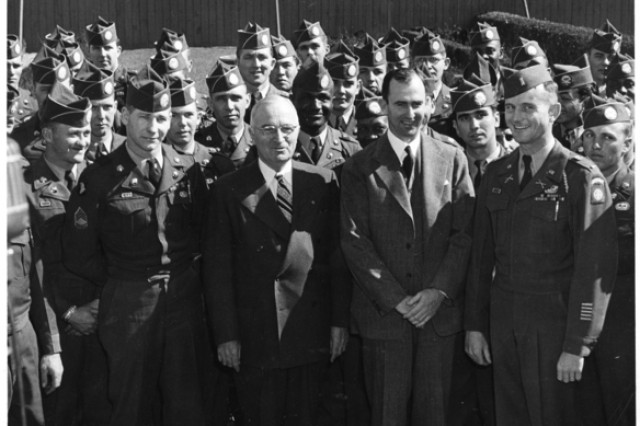 President Harry S. Truman and Secretary of the Army Frank Pace Jr. pose with members of the integrated 82nd Airborne Division on Feb. 27, 1951 at the White House Rose Garden. Truman signed Executive Order 9981 in 1948 but the armed forces were not fully integrated until 1954.