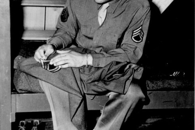 """Staff Sgt. Louis sews on the technical sergeant rank on April 10, 1945.  When many athletes were drafted into the services, Louis volunteered and used his celebrity status to recruit African Americans and boost the morale of troops all over the country. Lost in his popularity as the boxer known as the """"Brown Bomber"""" is the fact that he was the first golfer to play in a Professional Golf Association-sanctioned event."""