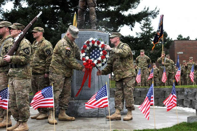 U.S. Army Col. Charles Webster, left, the commander of 3rd Stryker Brigade Combat Team, 2nd Infantry Division, and Command Sgt. Maj. Samuel Murphy, place a wreath at the brigade's Fallen Heroes Memorial during a re-dedication ceremony at Joint Base Lewis-McChord, Wash., Feb. 5, 2013. Murphy is the command sergeant major of 3rd Stryker Brigade Combat Team, 2nd Infantry Division. (U.S. Army by Staff Sgt. Chris McCullough/Released)
