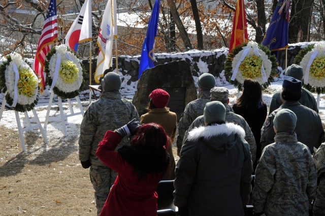 Military officials attend the 62nd anniversary ceremony for the Battle of Hill 180, Feb. 7, 2013, at the site where the storied Korean War bayonet charge took place.