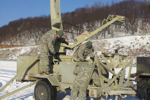 Signal Soldiers from Bravo Company, Brigade Support Battalion, 1st Brigade Combat Team, 2nd Infantry Division, set up a Command Post Node to establish tactical communications in support of 1/72 Armor Battalion live fire exercises3 Feb. at Rodriguez Live Fire Complex, South Korea.