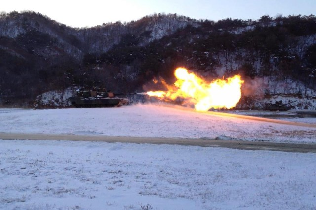 A Delta Company M1A2 Abrams Tank fires after confirming targeting data with the 1/72 Armor Battalion command post during a live fire exercise 3 Feb. at Rodriguez Live Fire Complex, South Korea.