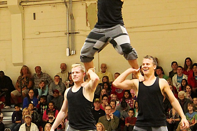 Members of the National Danish Performance Team go airborne Wednesday night at Fort Huachuca's Barnes Field House during their performance before a packed audience. Several hundred people turned out for the 90-minute show which featured gymnastics, dancing, jumping, tumbling and more.