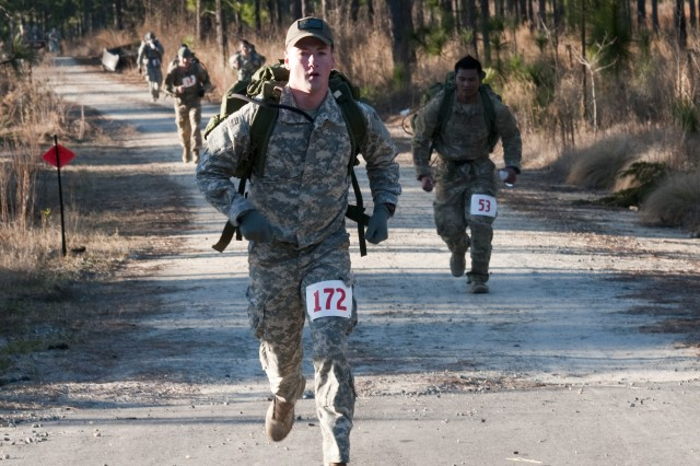 Sgt. Douglas McKee, of the 96th Civil Affairs Battalion, participates in the Fort Bragg Post Combat Cross Country Meet, Saturday, at Smith Lake. McKee was one of 103 servicemembers who vied to represent Fort Bragg at the Bataan Death March in New Mexico, March 17. The top five male and top five female finishers at the meet receive qualification slots.