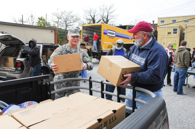Col. Sean Lee, Maryland National Guard state chaplain and Partners in Care creator, loads boxes filled with food donated from Knox Presbyterian Church in Baltimore.
